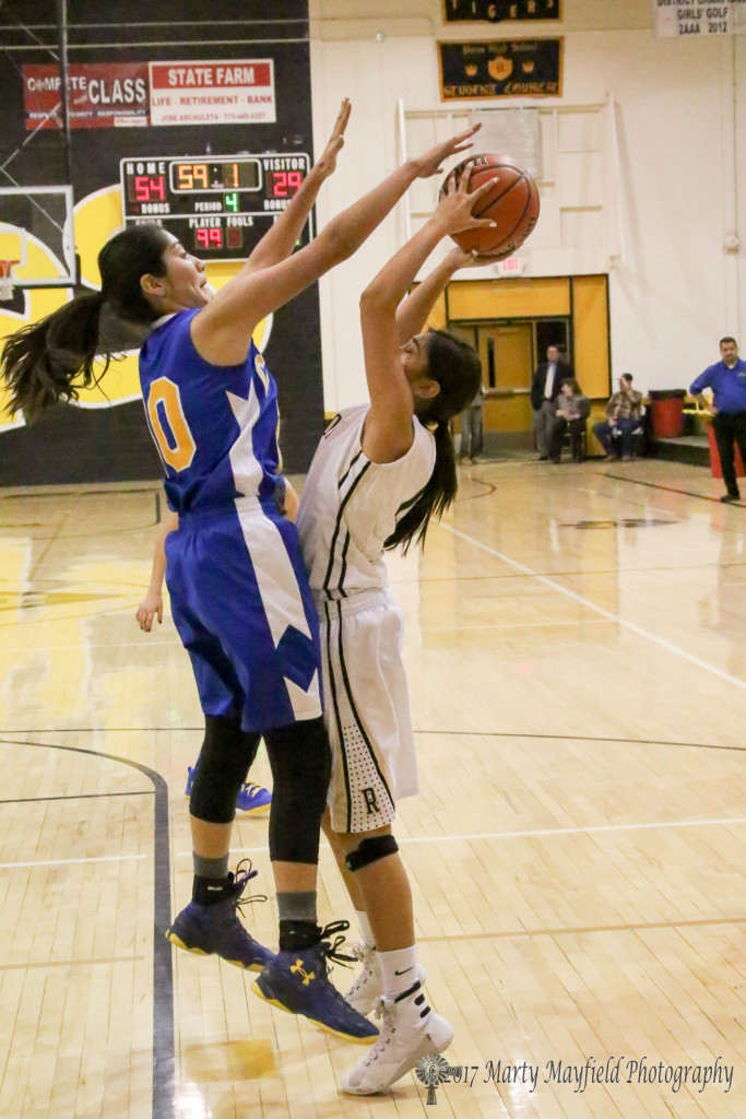 Jaelyn Garcia(10) goes for the block as Autumn Archuleta goes for the shot late in the game with Cottonwood Classical Thursday evening.