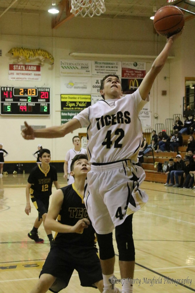 Aden Vanderwater takes the ball to the hoop as the Tigers did several times during the district tourney game Wednesday evening.