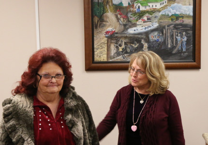 Jeannie Poulter was recognized by commissioners for her painting that now hangs in the commission chambers
