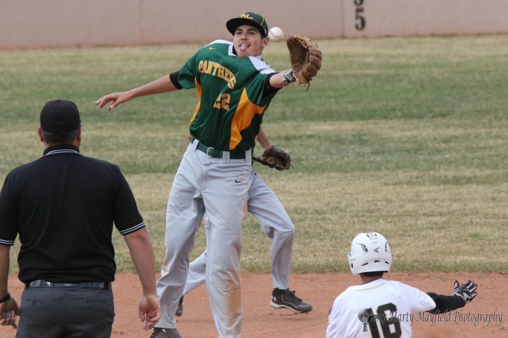 Richie Gonzales steals second during the district game with Pecos Tuesday afternoon.