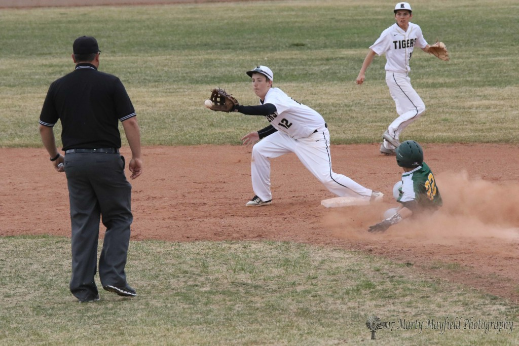 Jason Parker reaches for the ball as Cameron Quintana slides on the steal to second during the district game with Pecos Tuesday afternoon