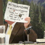 City Manager Scott Berry holds up a sign that the Vermejo Ranch brought in to him as a result of indiscriminate shooting on the Old Pass Road