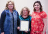 Michael Anne Antonucci and Tarin Giacomo accepted the proclamation for Women's History Month from Commissioner Lindé Schuster Tuesday evening at the city commission meeting.