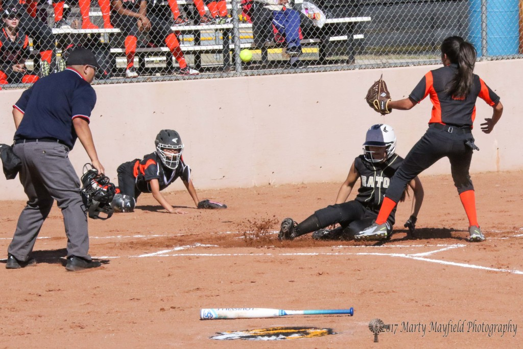 Andie Ortega beats the ball to home plate as she slides in home on the miss by catcher Aiden A.