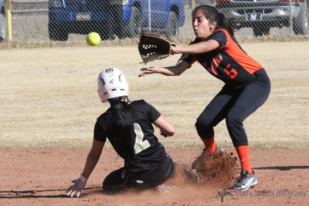 Natausha Ortega slides into second base just ahead of the ball to Heather A. of Clayton.