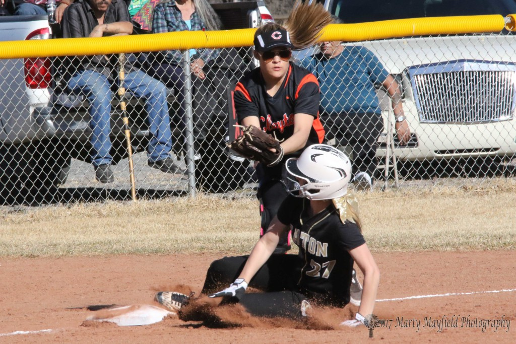 Camryn Mileta makes it to third as the ball slips out of the mitt of the third baseman