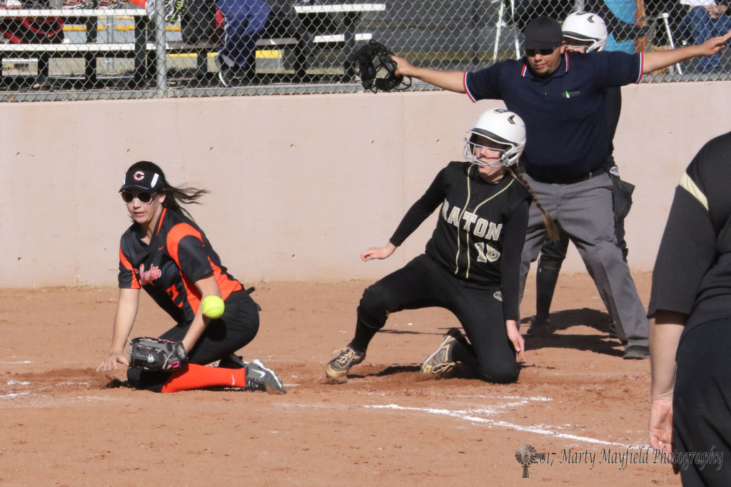 Halle Medina makes it home to end the game with a 15-0 win in the third inning Tuesday afternoon against Clayton