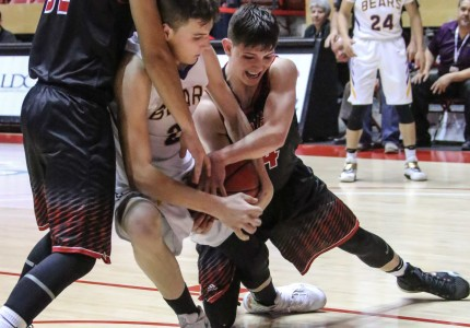 Kolton Riggs, Isaiah Garcia and Zac Caldwell struggle for the ball before the refs finally call a tie ball as both boys head for the floor Saturday morning in Wise Pies Arena