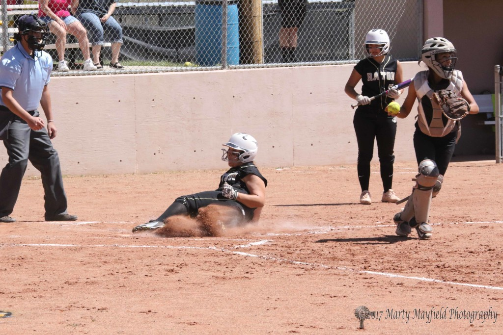 Sydnie Silva makes home plate catching the Lady Jaguar catcher off guard adding another Raton run.