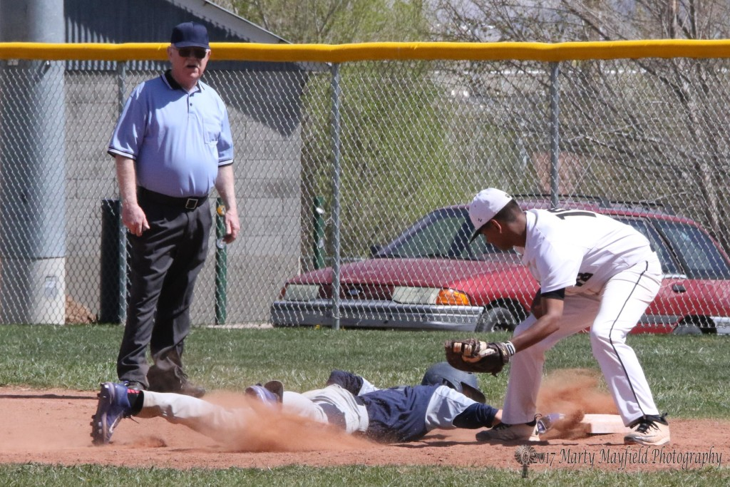 Jonathan Cabriales throws to Austin Jones at first as he attempts the pick off late in the second game of the double header with Santa Fe Prep Saturday afternoon.