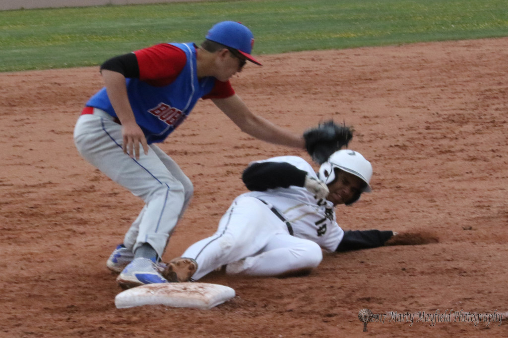 Austin Jones makes the slide into third well ahead of the ball Saturday afternoon.