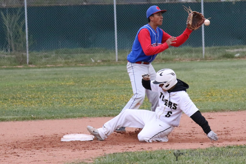 Trevor Portillos makes the slide safe into second base as Raton works their way to a 10-0 win in the district game.