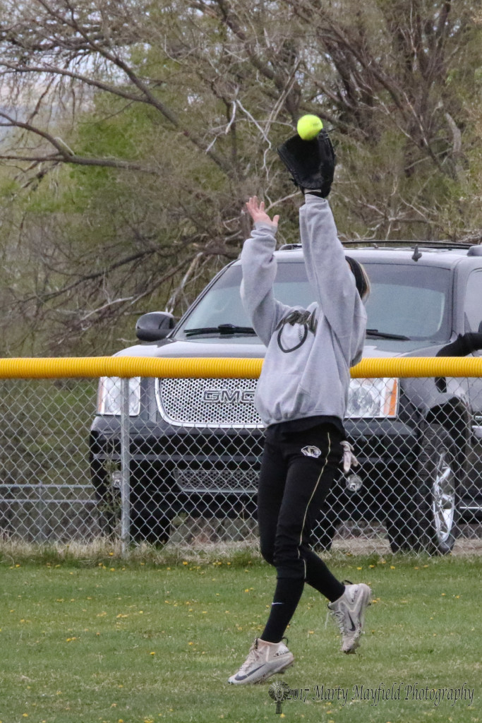Centerfielder Camryn Mileta makes the catch on the fly ball shutting down the Lady Bobcats in a district game Saturday afternoon.