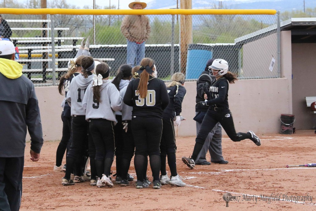 Crystal Ortiz is met at home plate but the team as she comes home after sending the ball over the centerfield fence Saturday afternoon.