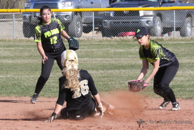 Camryn Stoecker slides safe into second as she steals the base on a base on balls.
