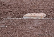 First base sits alone in the rain and sleet Tuesday afternoon during a brief stoppage in play.