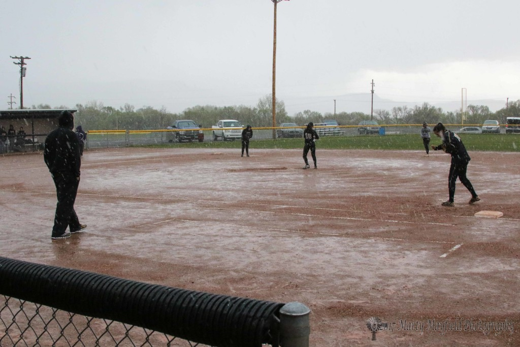 As Crystal Ortiz tries to dry the ball for the last pitch before the game with Tucumcari was called Tuesday afternoon due to rain in the top of the second inning.