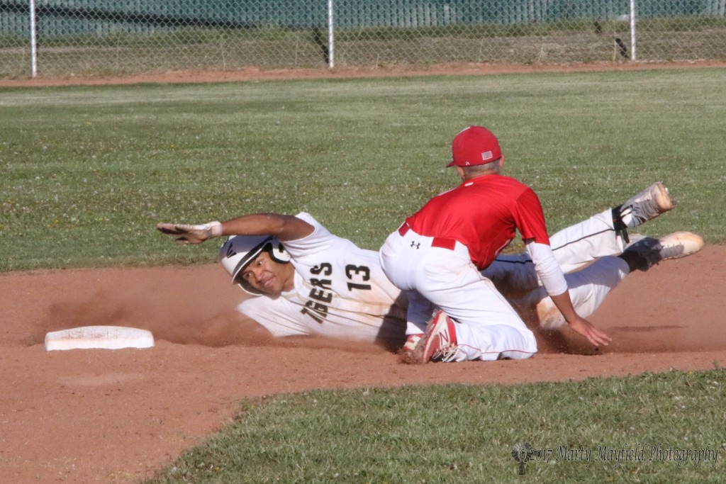 Jonathan Cabriales slides wide to second base but the call is out as he is tagged by shortstop Hayden Dean