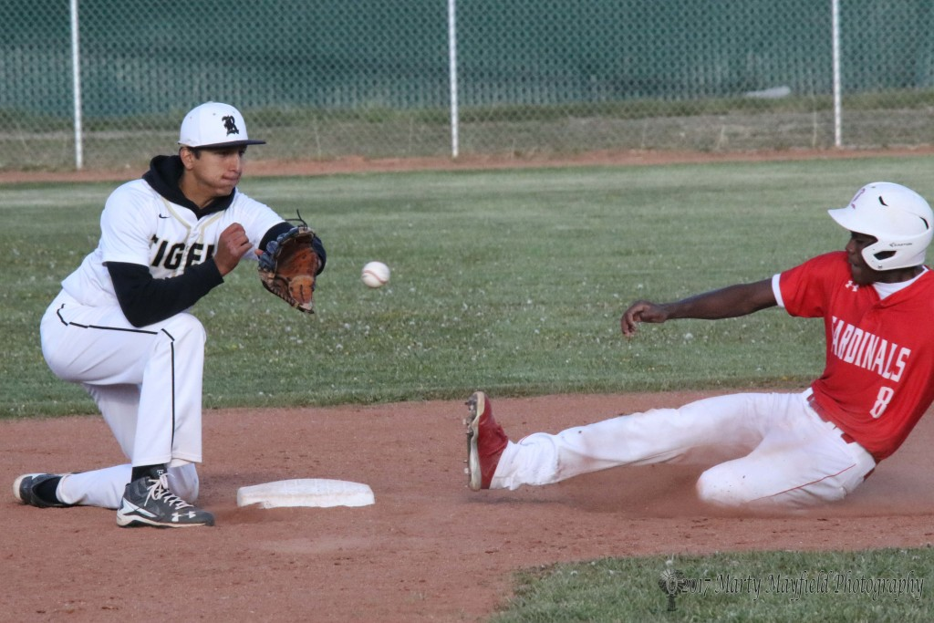 Cameron Santa Cruz beats the ball to second as Gabe Martinez readies for the catch and tag Wednesday afternoon.
