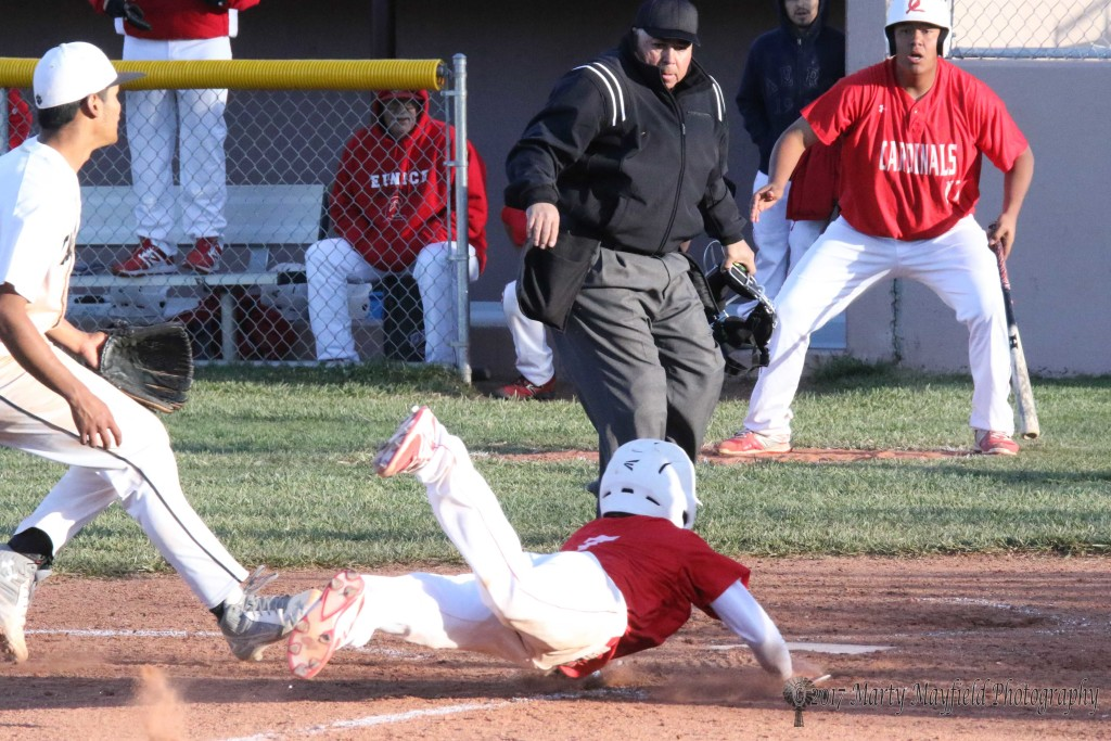 This could have been the winning run for Eunice as Hayden Dean slides home after a wild pitch goes over the reach of catcher William Holland in the top of the ninth inning.