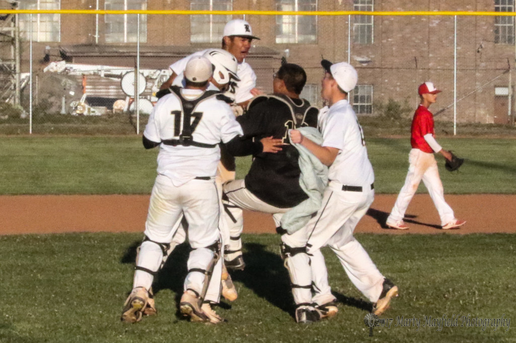 The celebration continues on the infield as Raton takes a 3-4 win over Eunice in a nine inning game Wednesday afternoon.