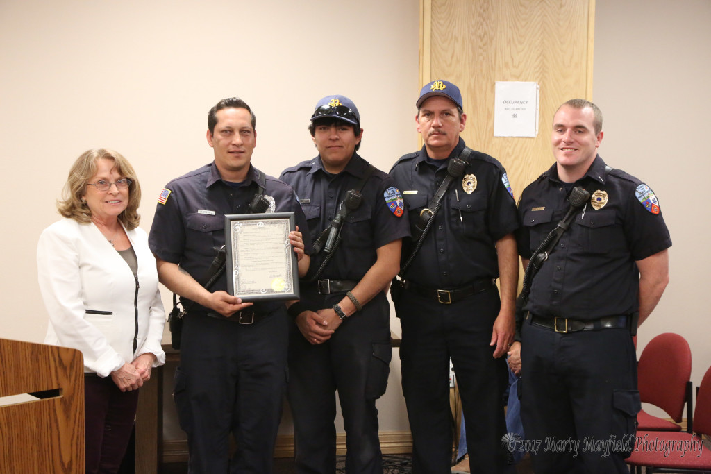 EMS personnel David Valdez, Christian Gonzales, Ken Gonzales and Jacob Butt received the proclamation from Commissioner Lindé Schuster for EMS week.