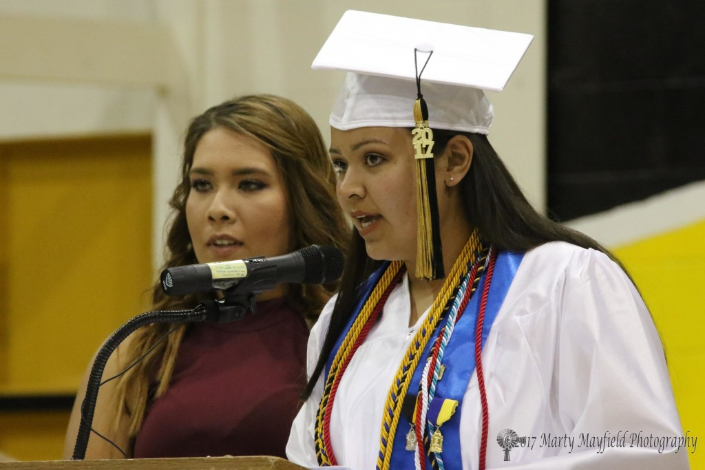 Senior Class President Camille Gonzales presented the key to the school to Junior Class President Sydni Silva during the 2017 RHS graduation ceremony held at Tiger Gym