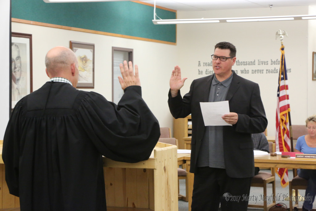 Abe Elliot was sworn in by Magistrate Judge Warren Walton Monday evening. He joins the board at a tough time as they struggle with a very tight budget.