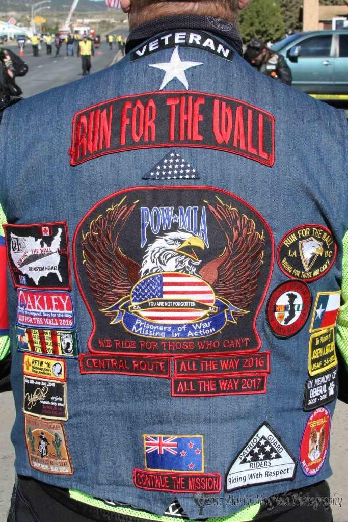 Veteran Edwin Musto displays his vest of patches and pins from the Run for the Wall. He hales from New Zealand and this is his second Run for the Wall ride.