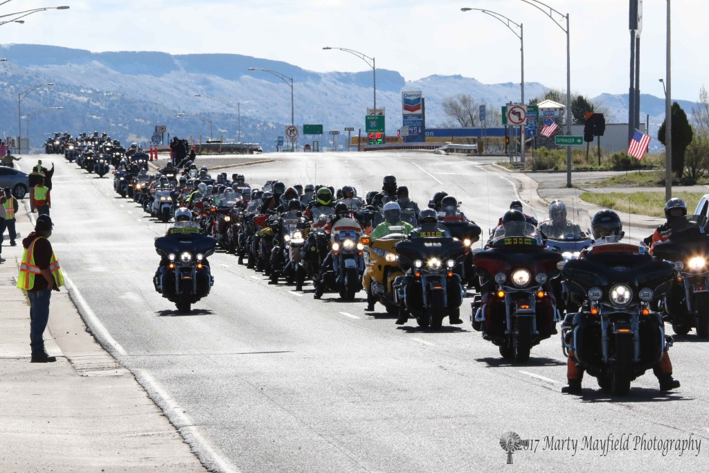 Run for the Wall participants ride down Clayton Road in Raton headed for the Alta Conoco Station for Fuel.