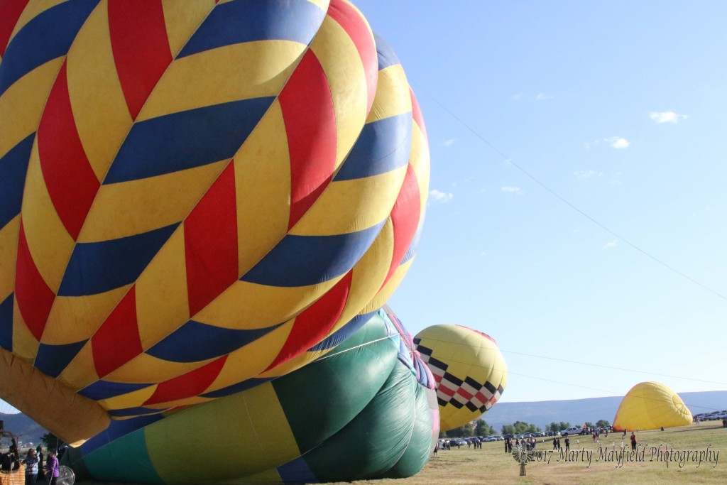 Balloons inflate Sunday morning to a good crowd and sun filled skies.
