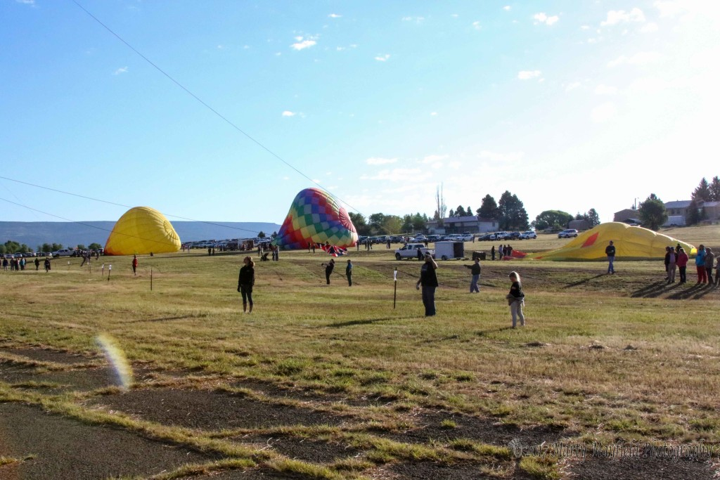 The crowd grew Sunday morning with several out of town visitors as well as locals. The parking area was filled with several cars Sunday morning as balloonist flew in bright sunny skies.