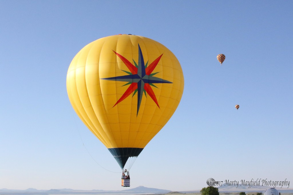 Lofty Piloted by Gerry Graff heads southeast as the ground winds move the balloon off the field.