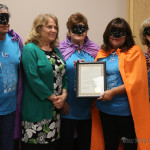 Kenny Cruz, Anita Vigil, Liz Tafoya and Mercy Swanson accept the Proclamation for this year's Relay for Life from Commissioner Lindé Schuster.