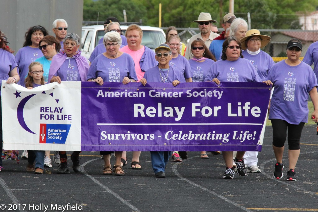 Survivors, young and old, take a lap around the track at Tiger Stadium Saturday afternoon during the 2017 Relay for Life