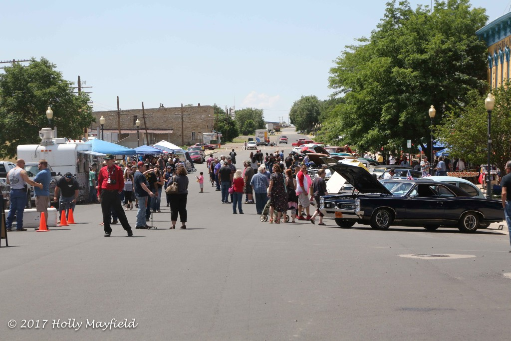 The crowds came and went during the day at the Run to Raton Car Show held on First Street Saturday at least until the skies opened up and sent many for cover.