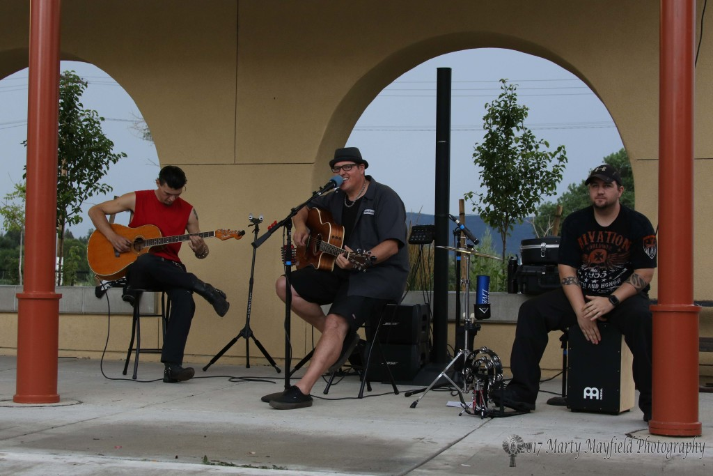 The group Secondhand, led by Abe Elliot with Matt Alcorn on guitar and Wesley Mayfield on percussion performed to a small crowd after the rains came and sent many spectators looking for cover.