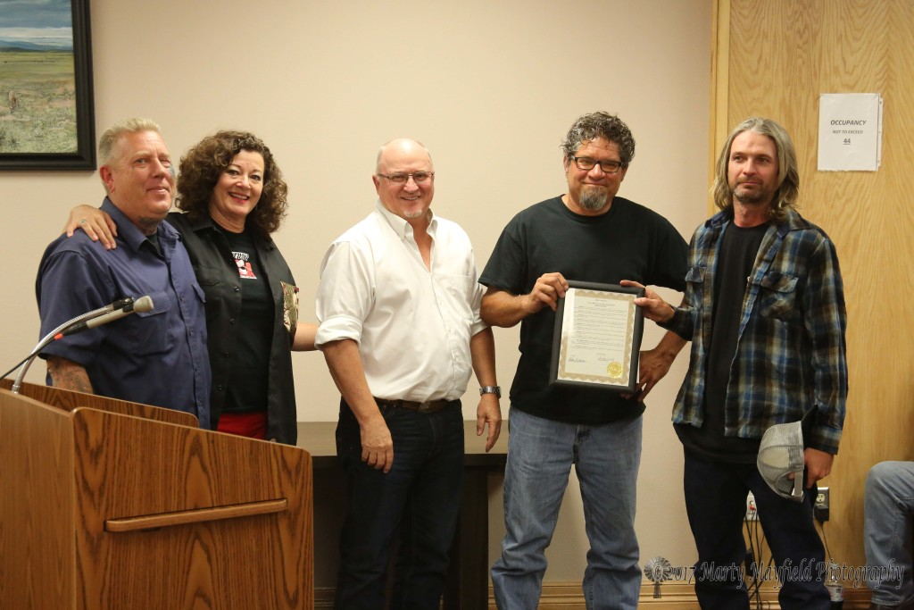 Jason Bennett, Laurie Bunker, Neal Cawley and JP Rodman accepted the proclamation for the Car Show and Bike Rally that was held in Raton last month. This year's event was such a success that next year's is already in the works.