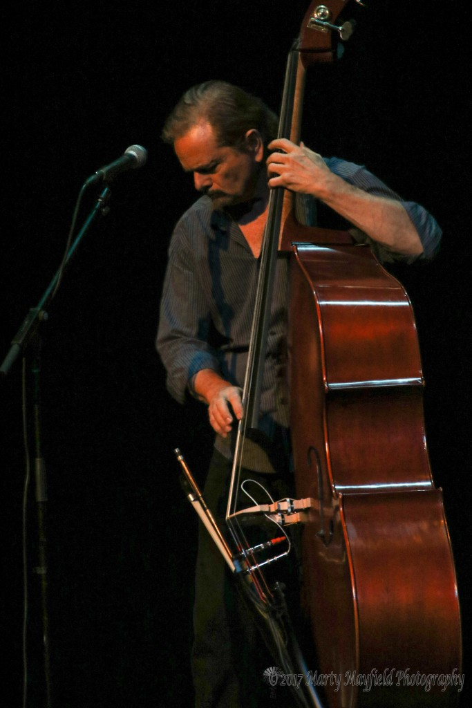 Charlie Chadwick performs on one of his specially designed basses. He designed the instrument to fold into itself to make it easy for airline travel.