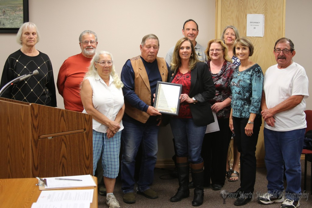 Colleen Grogan, Park Clark, Penny Sue Kuhns, Commissioner Ron Chavez, Melissa Unger, Ron Schuster, Dee Burks, Anita Moffit, Marian Ray and Victor Romero accept the proclamation for the volunteers at eh visitor's center.