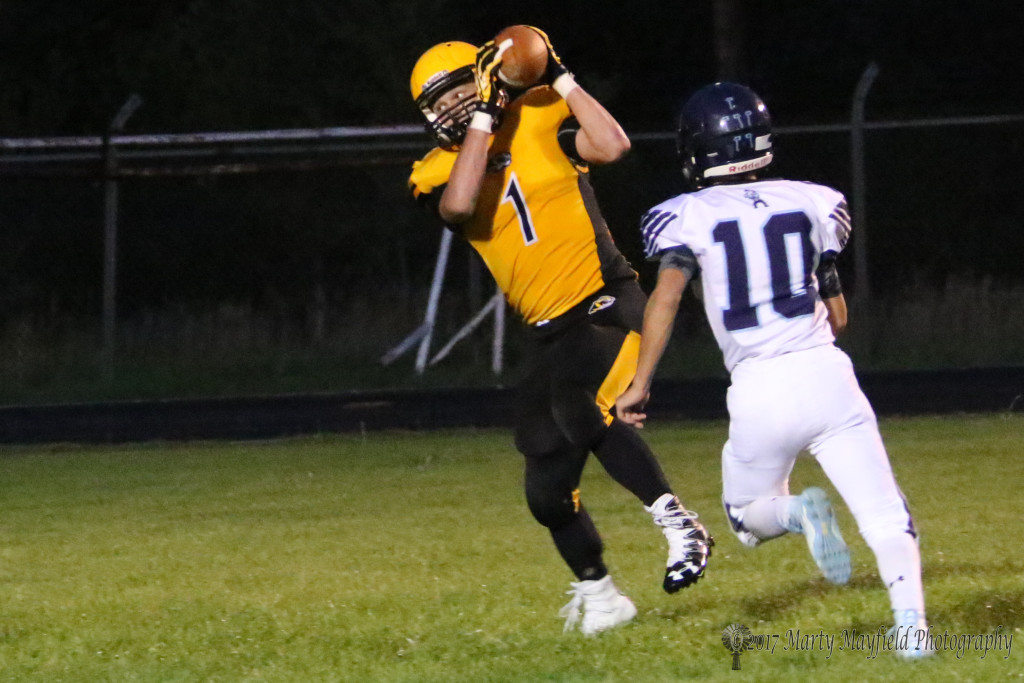 Nathaniel Tarbox makes the grab and steps into the end zone for another six for Raton in the Coal Bucket Game Friday night