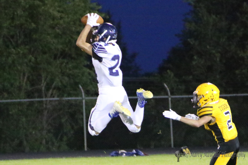 Dilan Villa makes a high flying catch with Richie Acevedo close behind for the tackle.