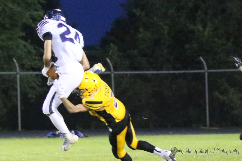 Richie Acevedo ,makes the tackle as Dilan Villa comes down with the ball Friday night.
