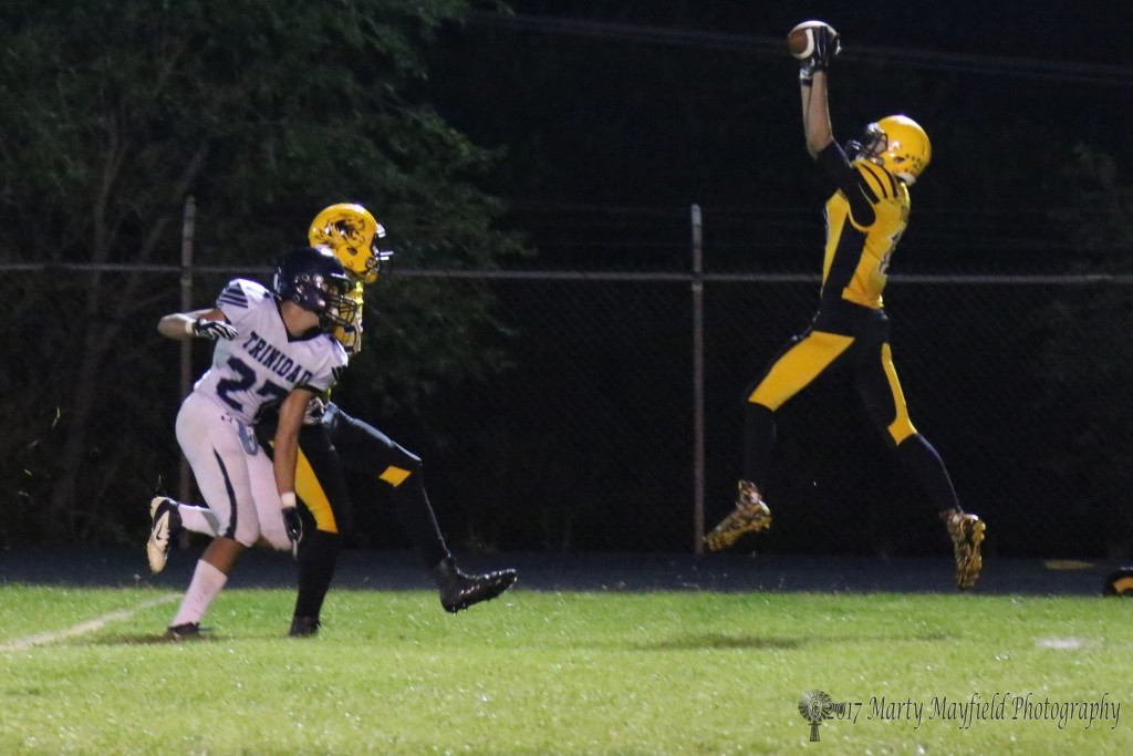 Aden Vanderwater makes the interception grab late in the Coal Bucket Game with Trinidad Friday night in Raton.