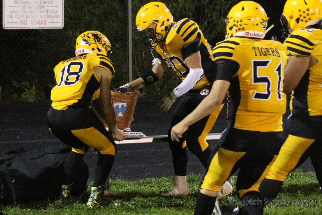 Seniors Dustin Segura(18) and Tristen Gallegos(20) go for the Coal Bucket as Raton brings it back to town with a resounding win over Trinidad Friday night in the Jungle.
