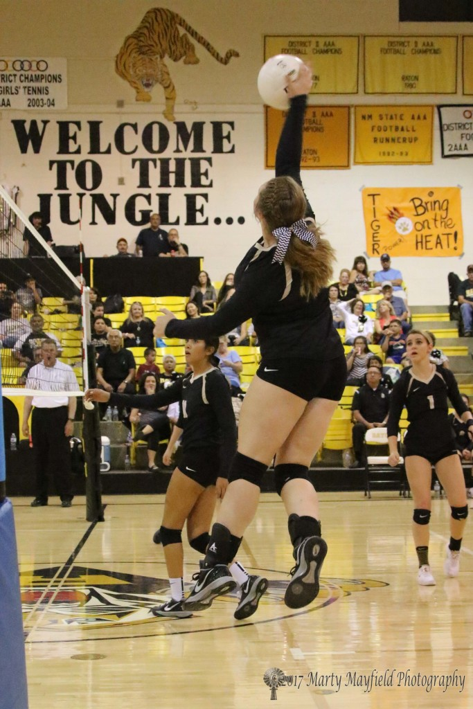 Jadyn Walton goes up for the spike Thursday evening in Tiger Gym.