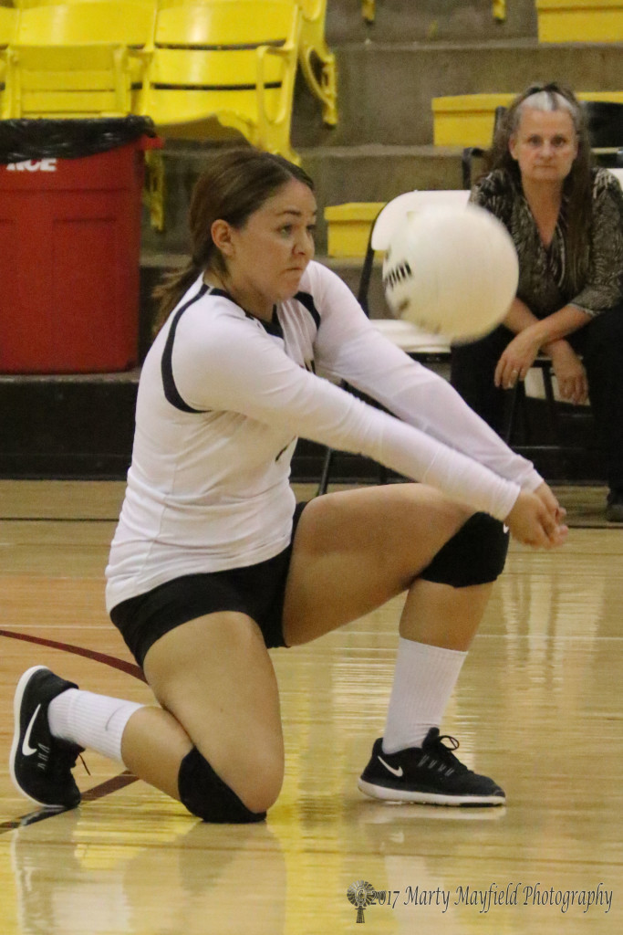 Andie Ortega takes a knee to make the pass during the second game against Clayton in Tiger Gym Thursday evening.