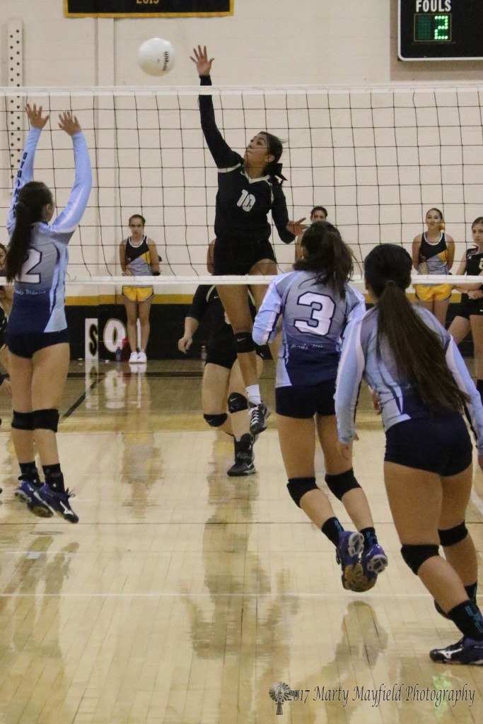 Its another slam over the net by Autumn Archuleta as Jessielynn Vallejos starts up for the block during the game in Tiger Gym Saturday afternoon.