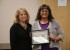 Beverly Baca was presented the You Rock award by Commissioner Lindé Schuster for her work on a fund raiser for a young child in need of medical treatment.