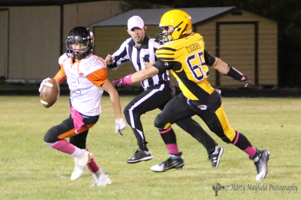 Cole Medina, in hot pursuit of Clayton QB Zachary Maynes in Raton's first district game at home.